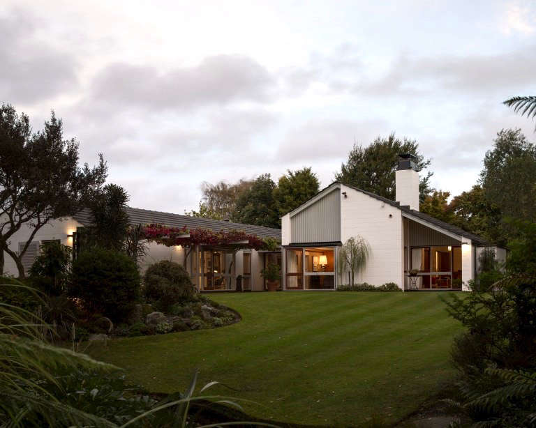 The trimmed lawn slopes down to a stream that runs through the property. Photograph by Sam Hartnett.