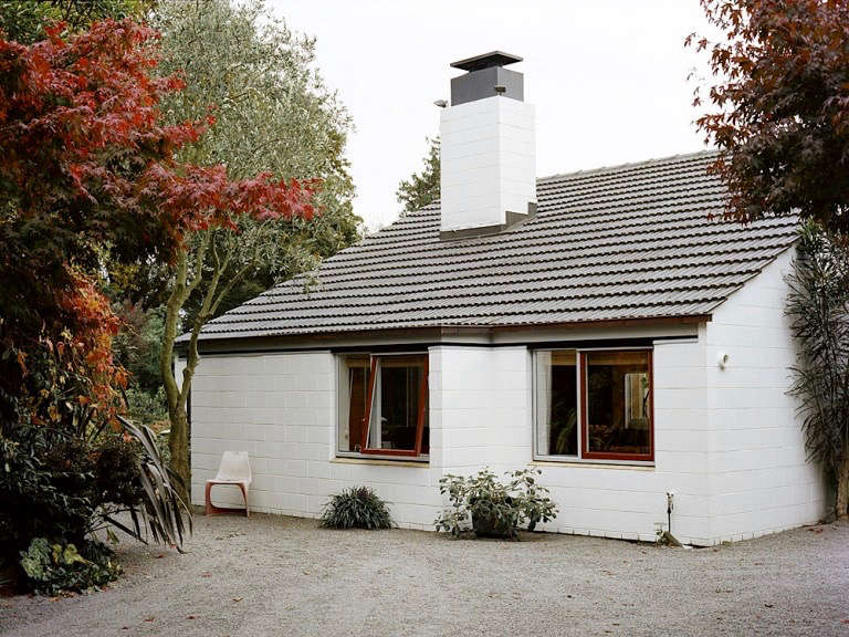 The house is located on a long gravel driveway. It&#8