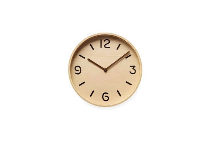 A Bi-Color Plywood Clock from Yuichi Nara has a wood face with die-cut numbers; \$95 at the MoMA Store.