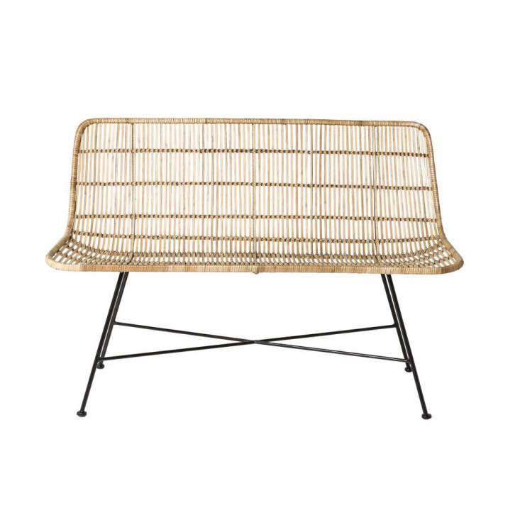 From Danish brand Bloomingville, a two-seaterNatural Rattan Sofa is happiest on a covered porch or indoors rather than in direct sunlight. It measures loading=