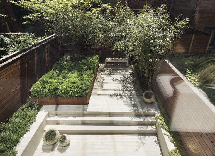 The garden has two levels, creating separate &#8
