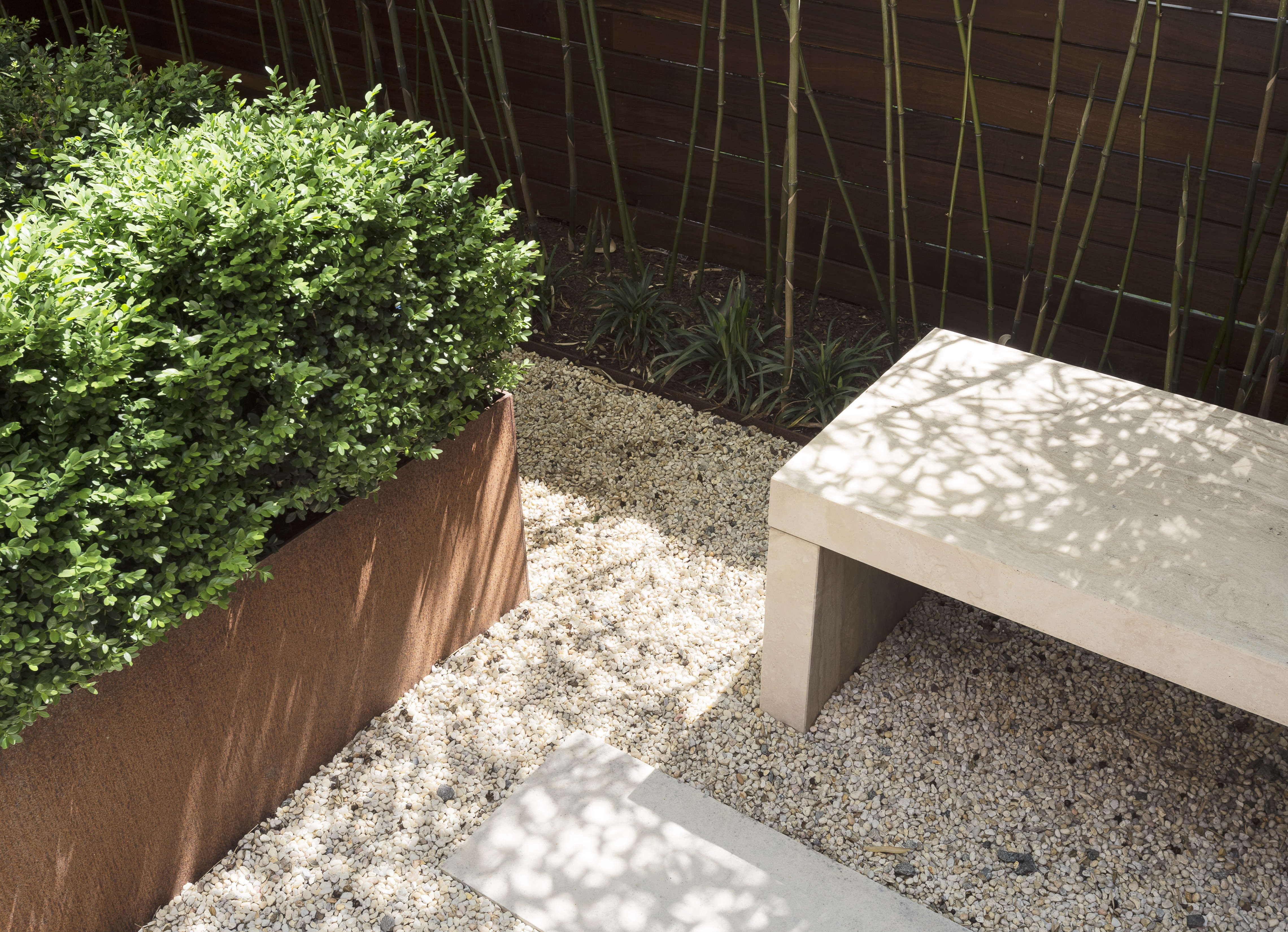 A path of limestone pavers set in pea gravel is &#8