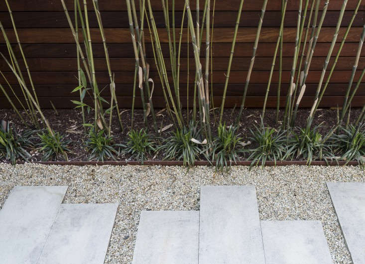 Metal landscape edgingis a staple of gardens. It keeps curvaceous materials such as stone and gravelcontained and creates a transition between lawn and garden bed. Photograph by Matthew Williams.