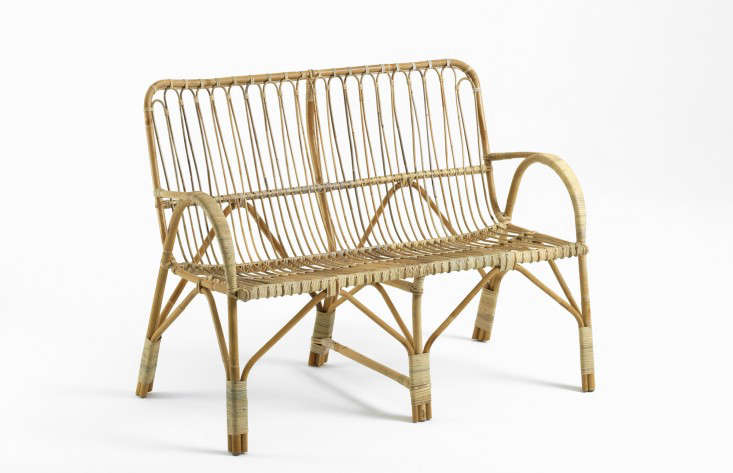 A Liggestolen two-seater rattan sofa designed by a Danish cane maker is 83 centimeters long (about 3\2.7 inches) and is €563 from Liggestolen.