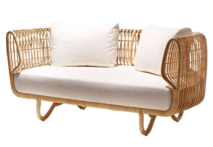 For sunrooms, screened porches, and covered spaces only: Alexa spotted a Nest Sofa from Danish designers Foersom & Hiort-Lorenzen. Made of sustainable rattan, it&#8