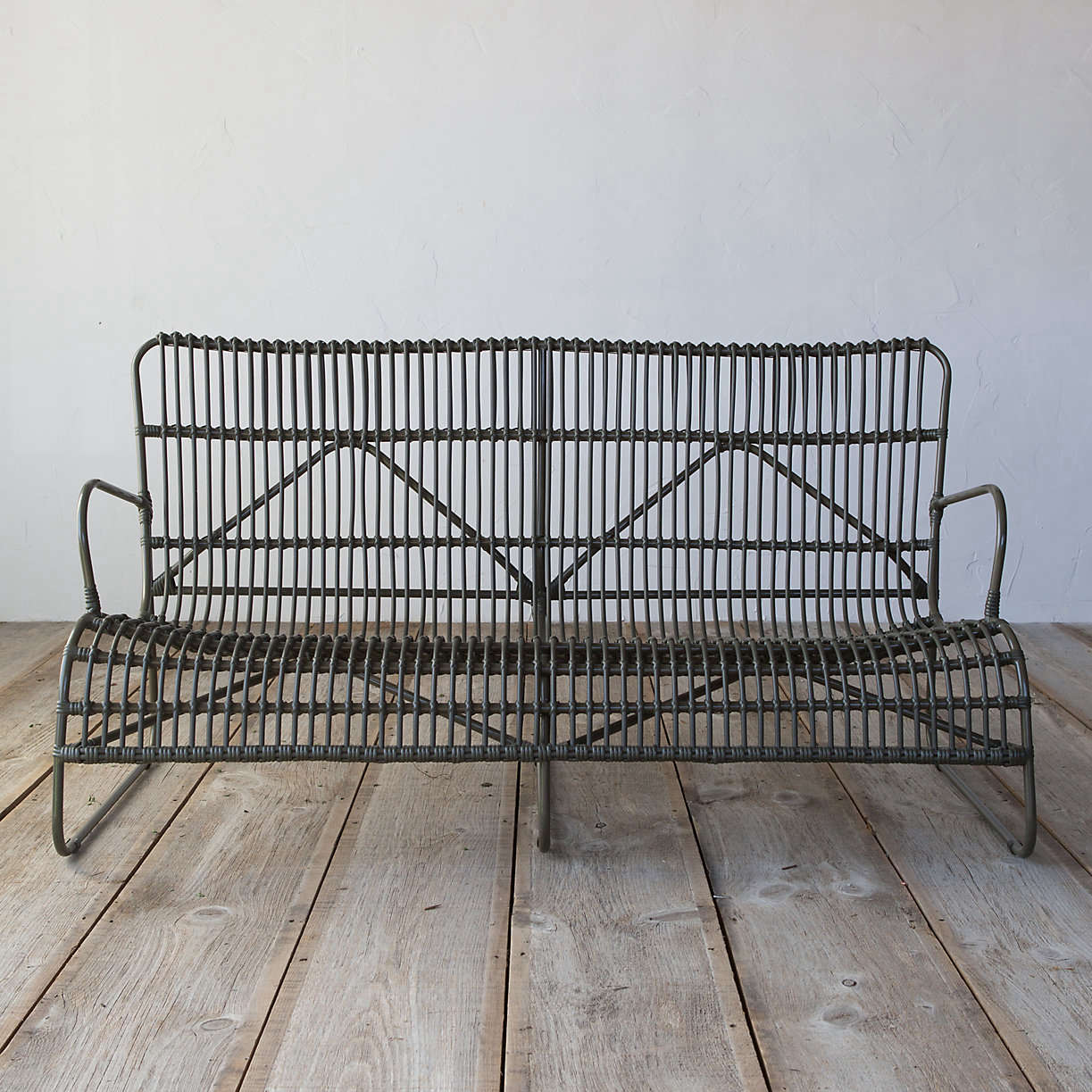 An Open Weave All Weather Wicker Sofa stands up to the weather, withpolyester rattan woven around a powder-coated aluminum frame. It measures 58.loading=