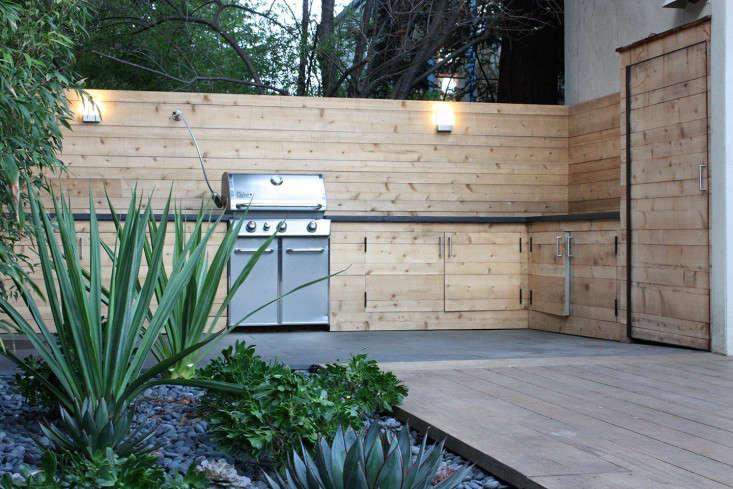 outdoor-kitchen-brennan-cox-grill-countertops-storage-fence-gardenista