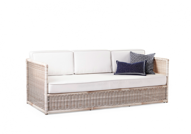 A Pacifica Sofa woven ofall-weather resin on a powder-coated aluminum frame comes with cushions covered in all-weather Sunbrella fabric (cushions are available in white, shown, and in denim). It measures83inches long; $