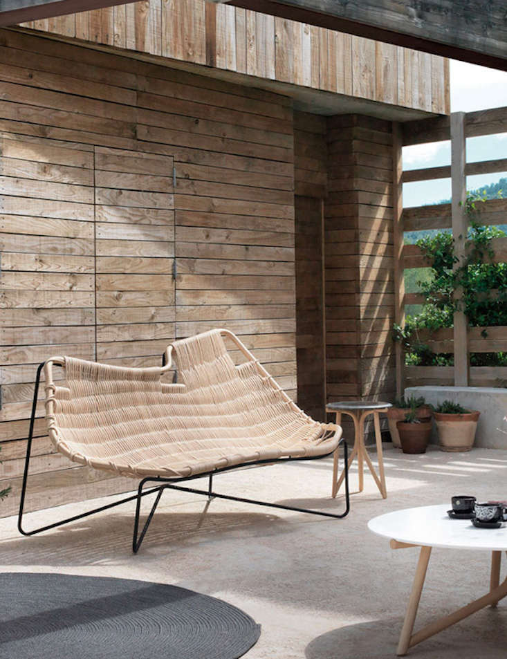 A wickerwork Pepe Sofa from design studio Tina & Pepe is woven of natural materials.