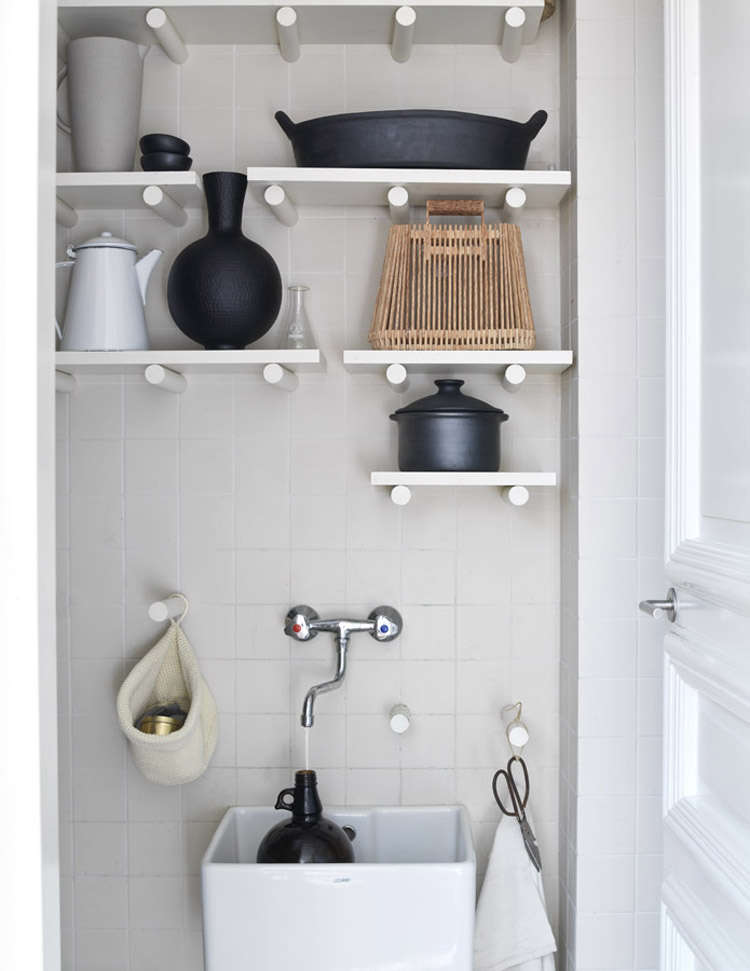 A closet converted into an orderly utility space complete with pegboard wall. Find more ideas like this one in  Favorites: Pegboard Storage Organizers. Photograph by Louis Lemaire Fotografie, courtesy ofKim Timmerman.