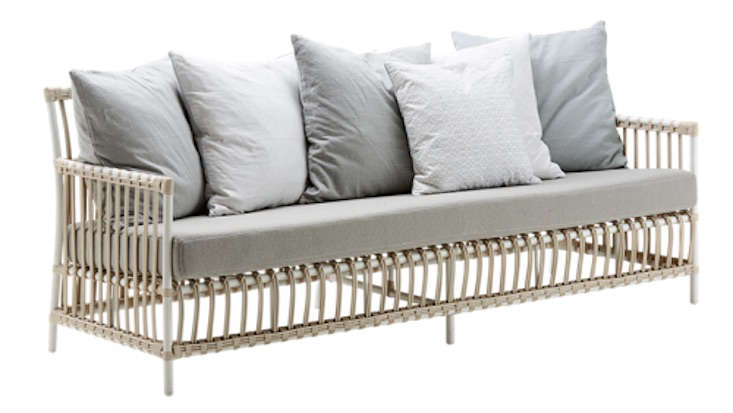 From Sika Designs, a three-seaterCaroline Sofa made with rattan from Indonesia is suitable for use outdoors or in. It is 7 centimeters long (about 77.5 inches) and is $