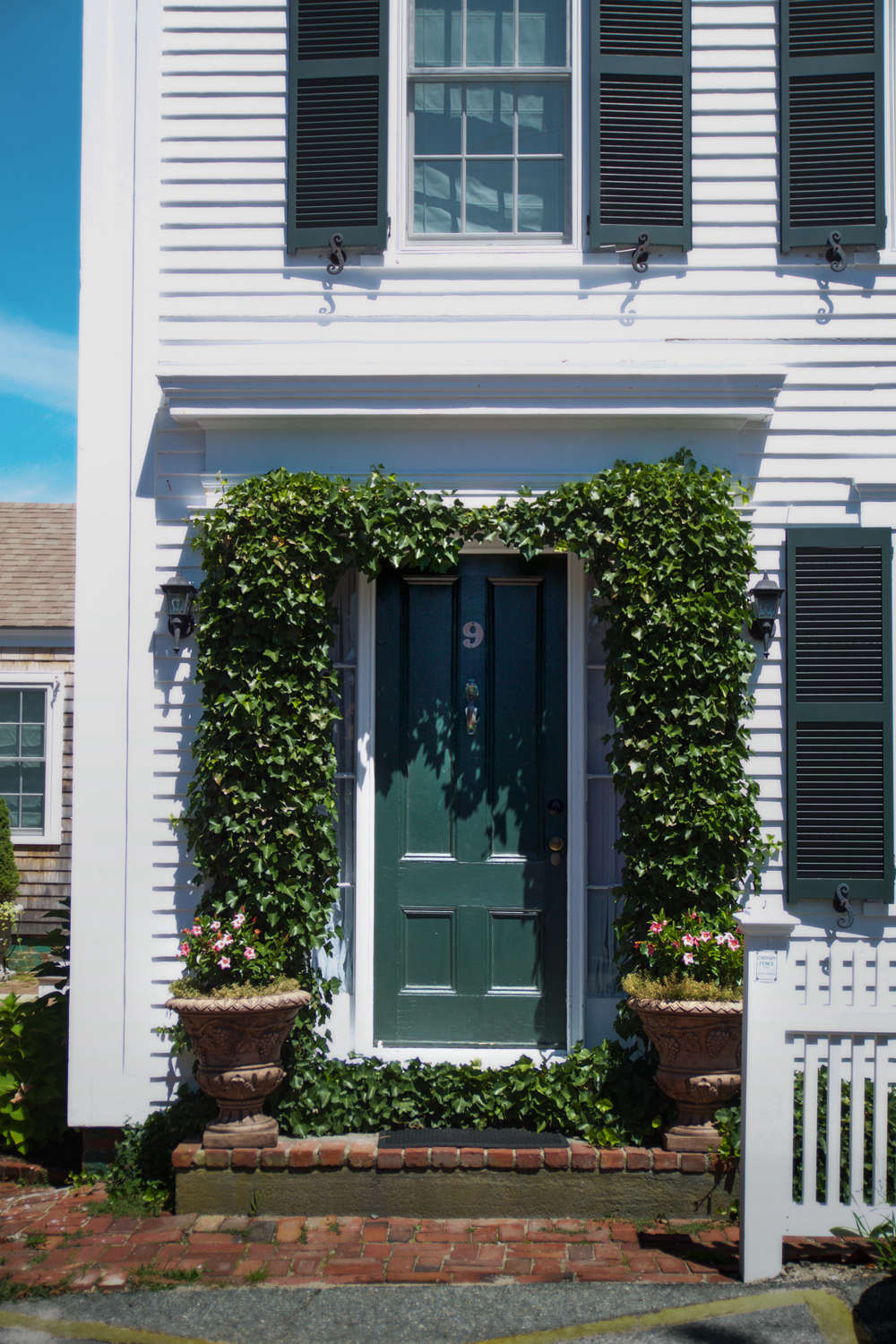 On our way to one of Tim&#8\2\17;s gardens, we passed an ivy-framed doorway that has a cooling effect on a sun-bleach facade of a classical house.