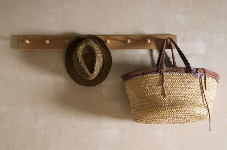 The Shakers lined nearly every room in peg rails, one of their most versatile inventions, which they used to store everything from clothes to brooms to chairs. Adapt this for the garden, and hang one (or several) in a shed or entryway for easy storage of tools and outerwear. Source a few of our favorites, including the one shown here, atObject Lessons: The Shaker Peg Rail over on Remodelista.
