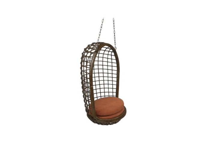 A Mid-Century Woven Rattan Hanging Egg Chair is \$\1,400 from \1st Dibs.
