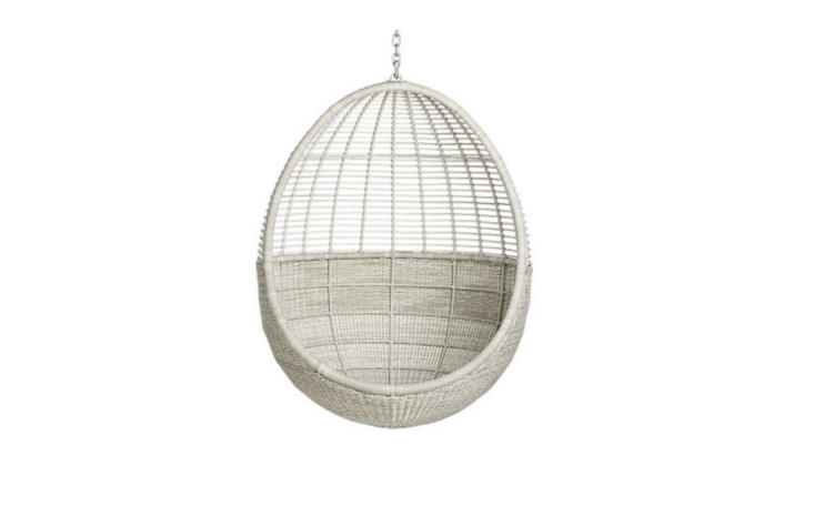 A Pod Hanging Chair has a powder-coated aluminum frame with a woven recycled resin shell; \$6\28 from CB\2.