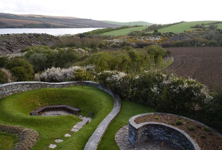 Irish landscape designer Mary Reynolds created an undulating landscape in a remote, untamed place on the Cornish coast with organic, sinuous forms that echo the way the land rolls down to the water. See more in Landscape Designer Visit: Spirals in Stone on the Cornish Coast by Mary Reynolds. Photograph by Photograph by Dan Duchars.