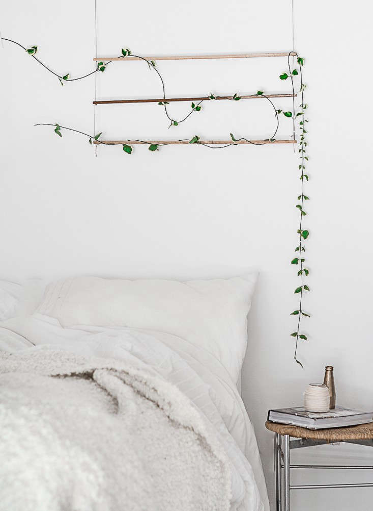 Blogger Agata Dimmich of Passion Shakemade a DIY wall hanging to add a vine to a bedroom. For more, seeDIY: An Indoor Trellis for Climbing Vines.