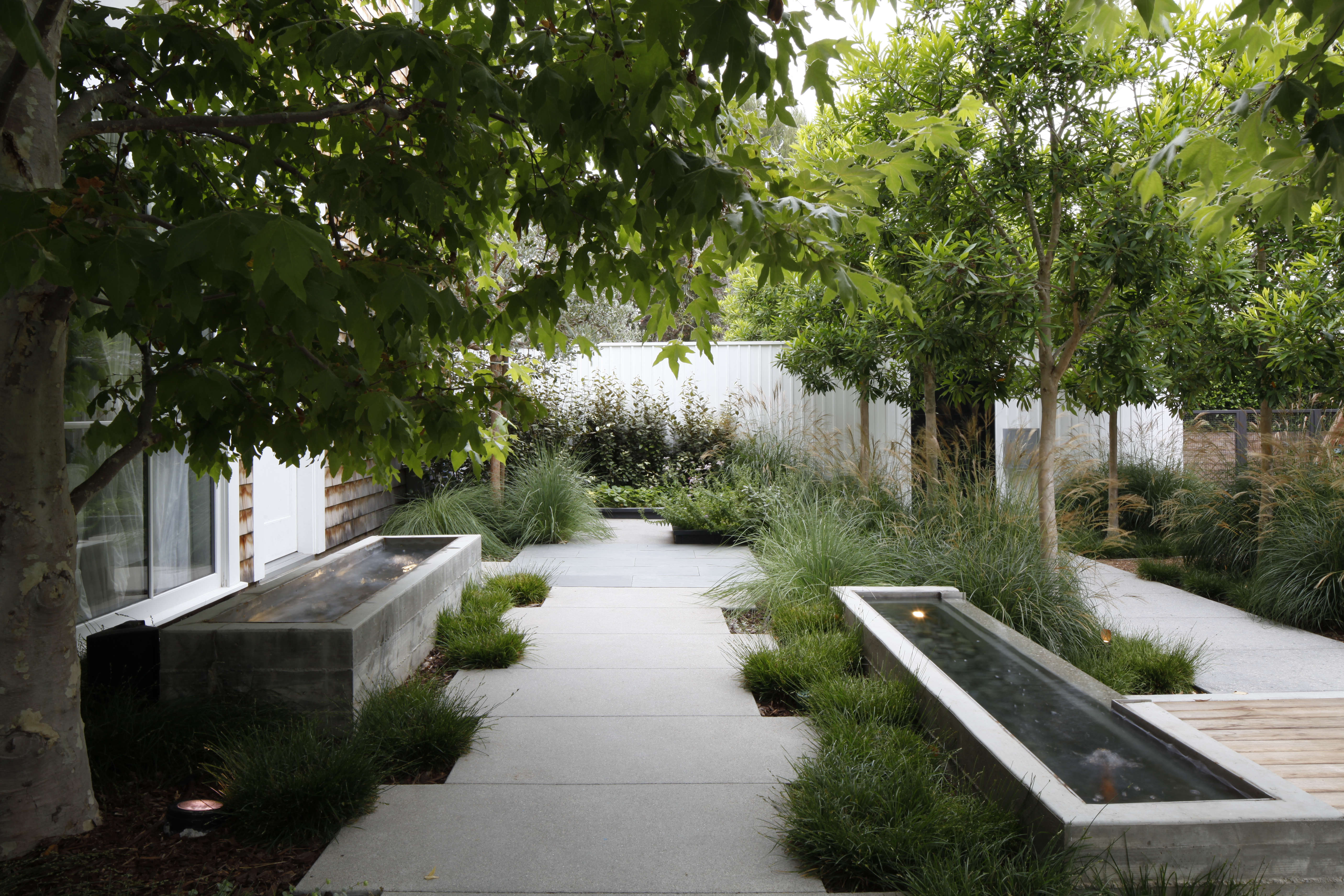 Photograph by Art Gray. In Los Angeles a walkway in a Pacific Palisades garden designed by Mark Tessier Landscape Architectureis flanked by mirror-image fountains.