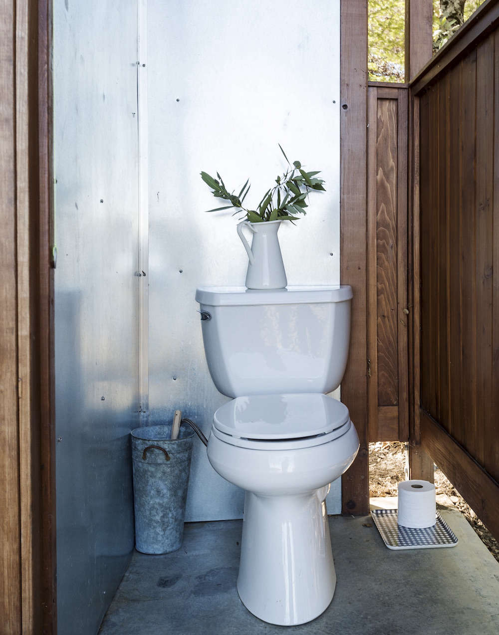 Outdoor Toilet with Stainless, Concrete, and Wood