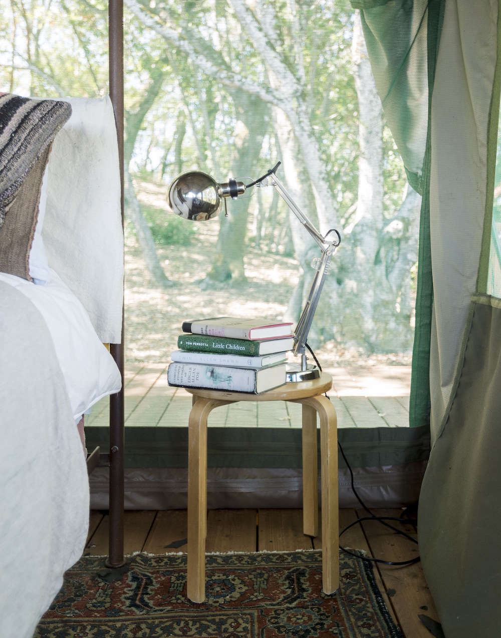 Aalto Stool with Books and Light as Bedside Table