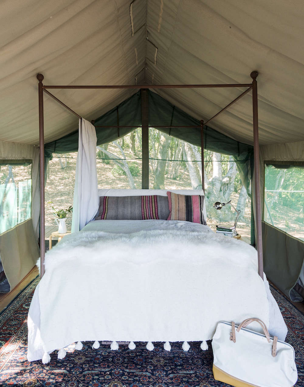 White and Wood Outdoor Glamping Bed in Tent