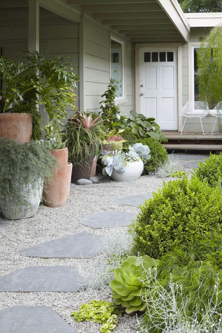 Stepping stones are sliced basalt from American Soil and Stone. Grubb chose them for their shape and color. They&#8