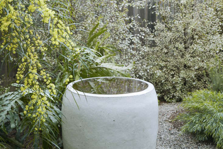 Inspired by one of her favorite landscape designers, Bernard Trainor, Grubb installed the most simple of fountains. &#8