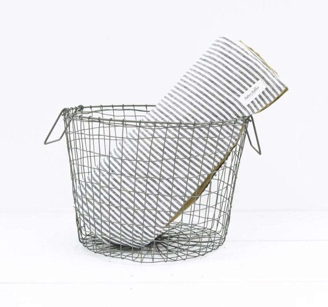 The Fog Linen Basket is a round wire basket with wire handles, measuring 37.5 cm in diameter and .5 cm tall; $95 NZ from Father Rabbit.