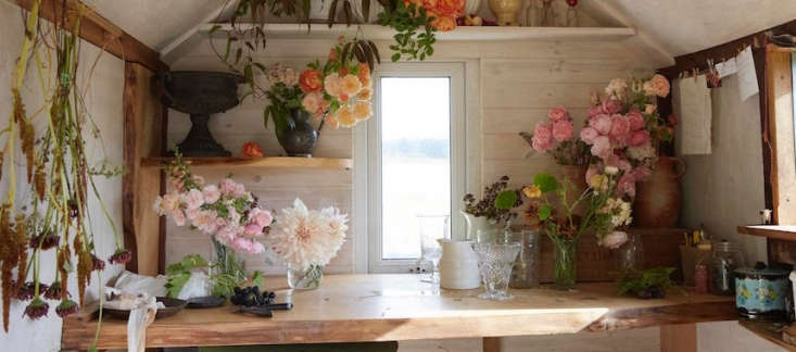 """Shropshire, UK-based florist Tammy Hall has a small studio in a former shepherd's hut """"rescued from a field at the top of the farm where it had been for years and years,"""" she says. """"It now sits at the top of my field and is my quiet thinking space."""" Photograph by Britt Willoughby Dyer."""