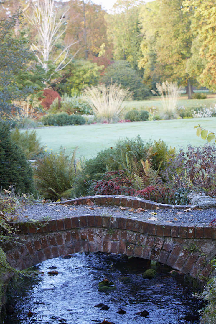 Llanover round garden with bridge crossing stream in South Wales