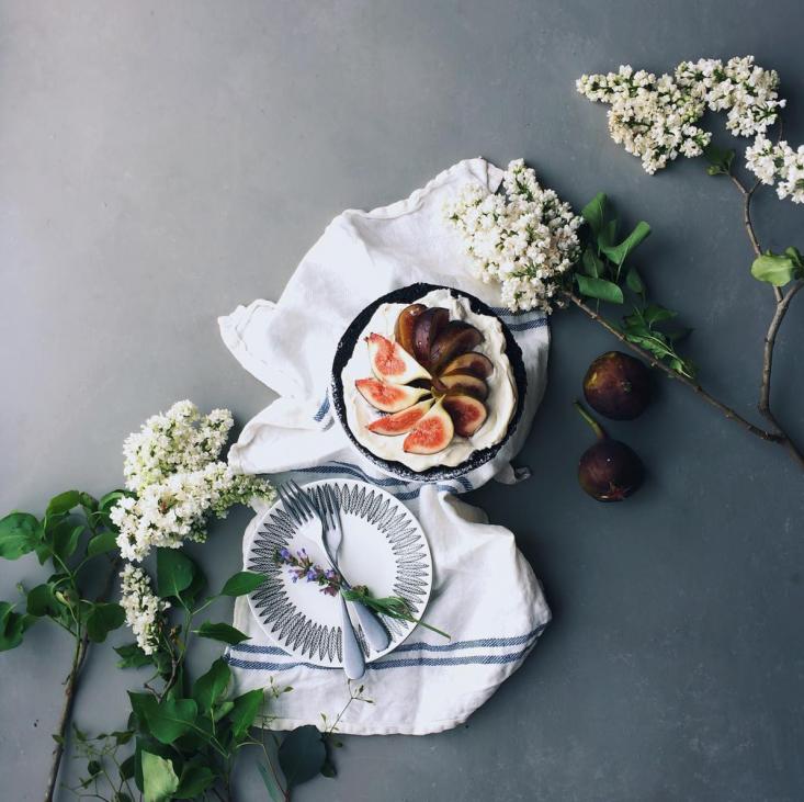 Plum cake and lilacs by Yukiko Masuda; seeStudio Visit: Quiet, Moody Flower Studies by Yukiko Masuda for more.