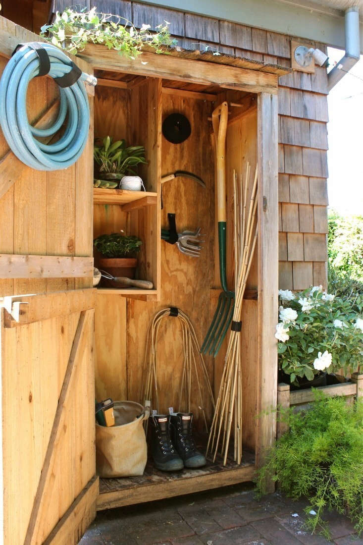 Remodelista editor in chief Julie Carlson has a tiny DIY kit shed in her garden in Mill Valley, California. Photograph by Michelle Slatalla.