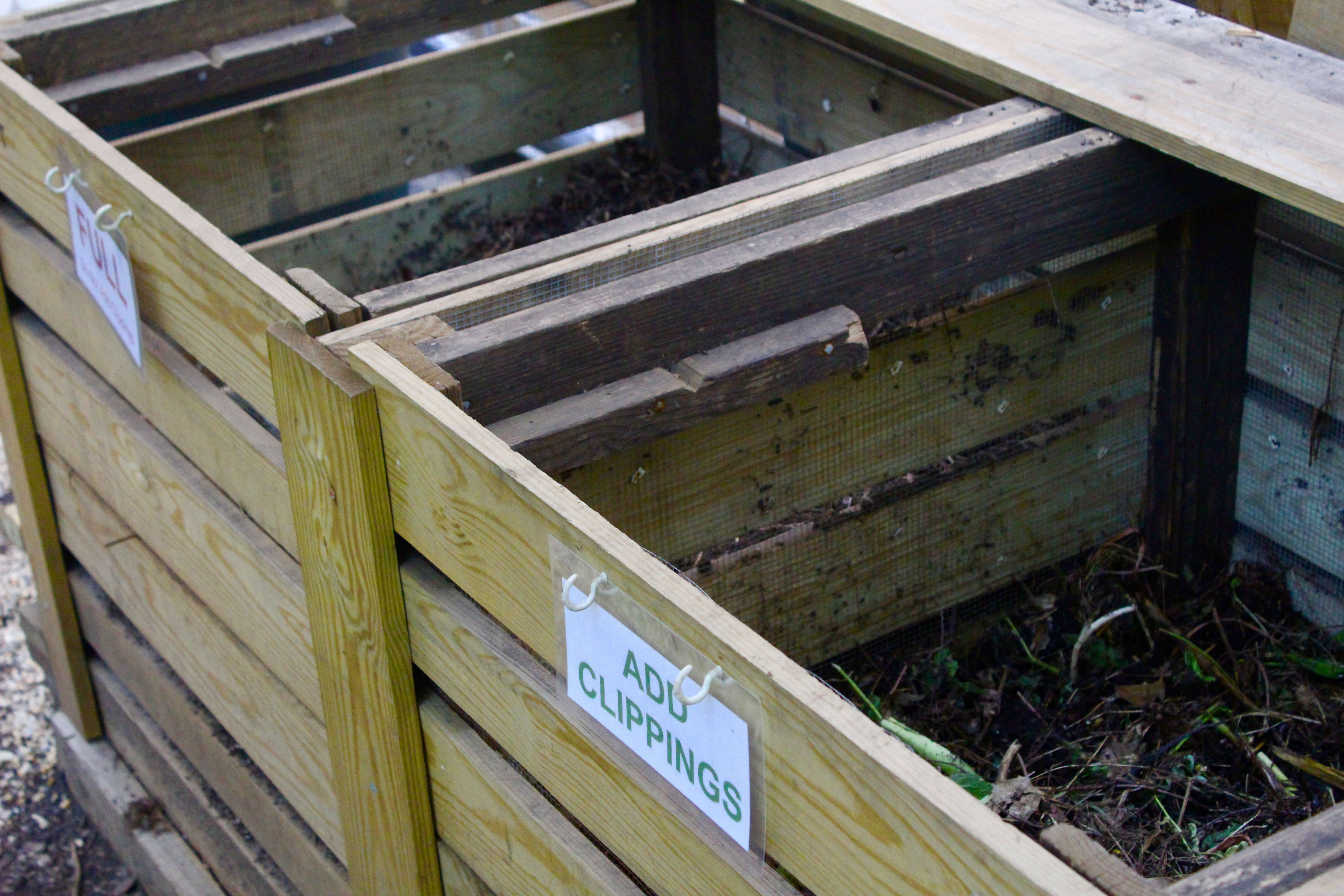 Plot holders are responsible for cutting up plant debris from their gardens before adding it to the compost. After that, a single person manages the bins to ensure clippings stay moist and aerated.