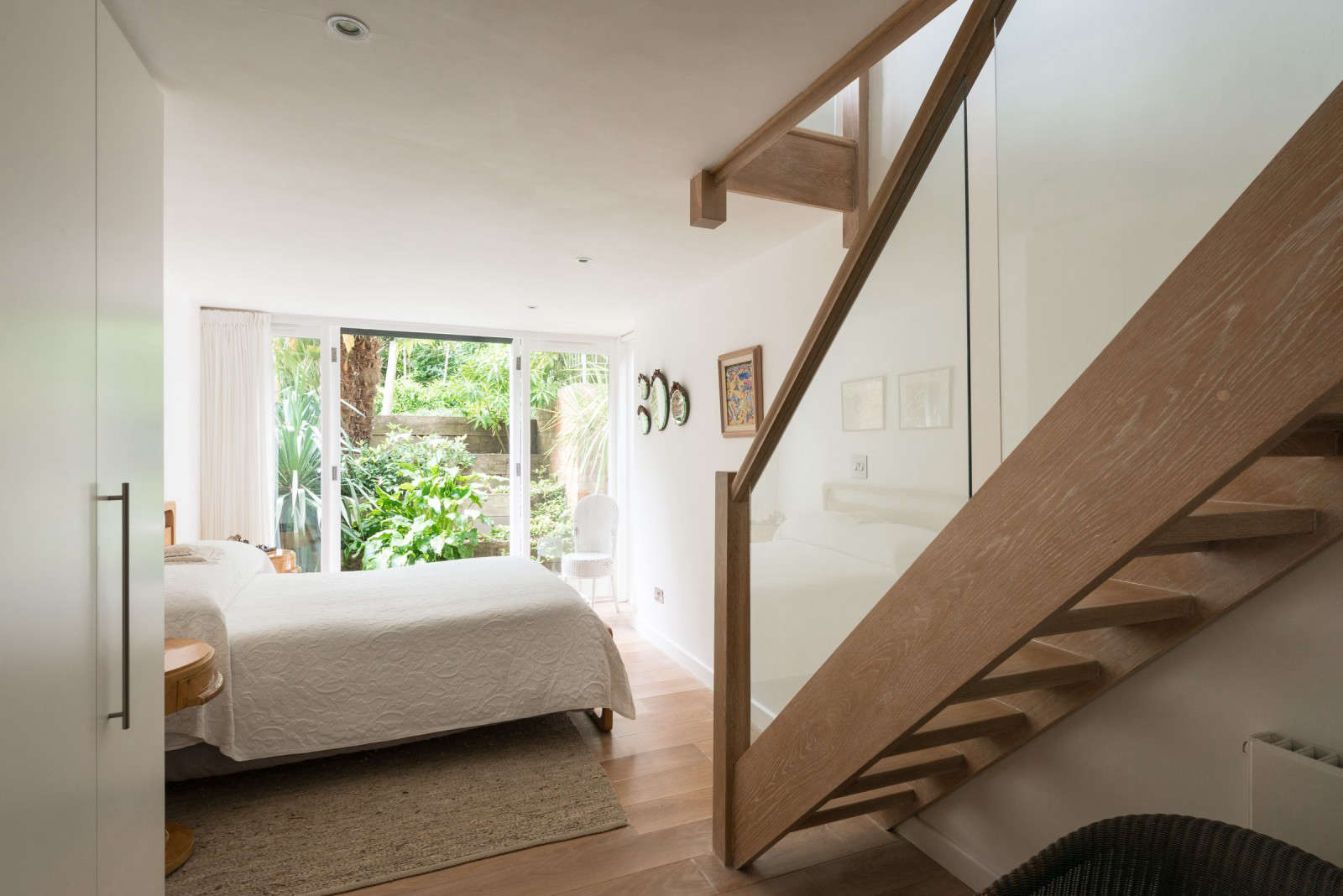 greenhouse-conversion-kent-themodernhouse-bedroom-french-doors-3