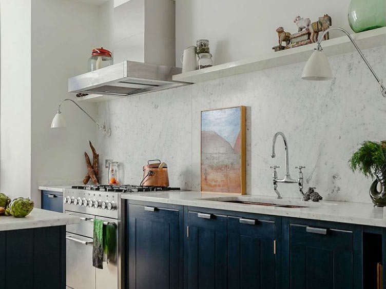Art has a place in the kitchen, too! Here, a beautiful landscape painting gets place of honor. Photograph by Alexis Hamilton for British Standard, from  Favorite Solid Marble Kitchen Backsplashes, for Maximum Drama. (For more examples of art in the kitchen, see The New Art Gallery: src=