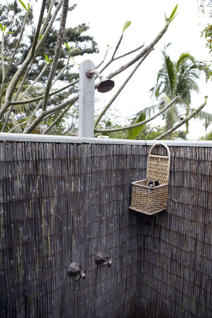 An outdoor shower by decorator Tom Scheerer has walls made of bamboo panels. For more of this project, see Island Life: At Home with Tom Scheerer on Remodelista. Photograph by Francesco Lagnese courtesy of The Vendome Press.