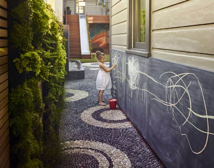 A chalkboard area in a garden designed by Monica Viarengo