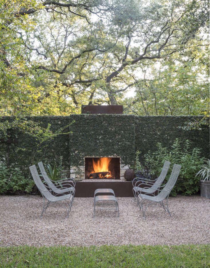 Photograph by Matthew Williams. Landscape architect Christine Ten Eyck prunes her creeping fig vines twice a year to keep them under control in her Austin, Texas garden. For more of her garden, see Gardenista: The Definitive Guide to Stylish Outdoor Spaces.