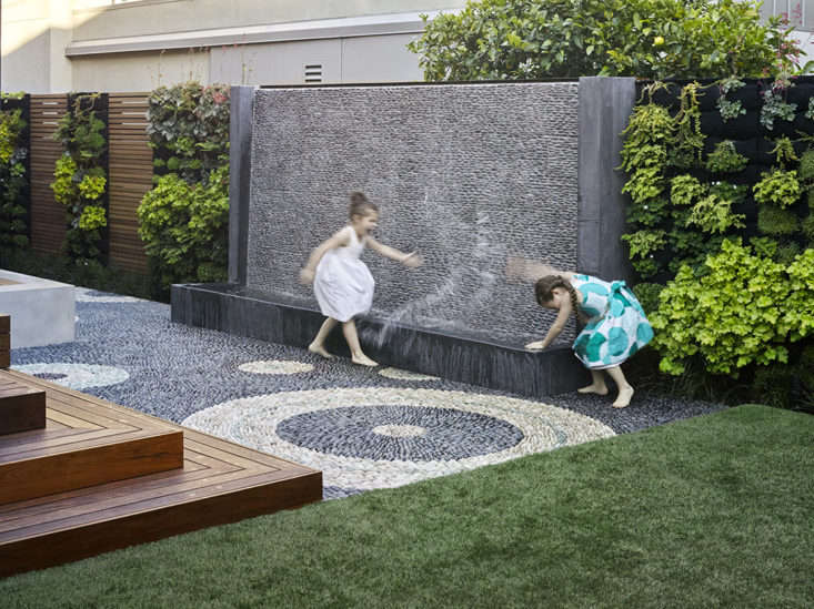 A water wall designed by Monica Viarengo for a childrens playscape