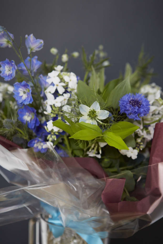 A bouquet in hues of blue and bright whites for the Mother of the Bride, thoughtfully handtied and finished in cellophane with enough water to ensure longevity for the duration of the wedding.
