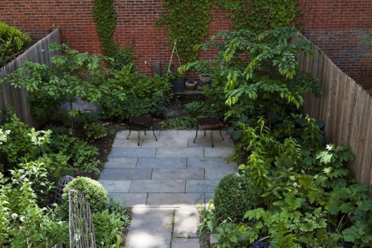 To create this budget patio, the owners reused the bluestone that was already in the garden by rearranging and supplementing it. Photograph by Nicole Franzen for Gardenista, from The Magicians: An English Professor and a Novelist Conjure a Garden in Brooklyn.