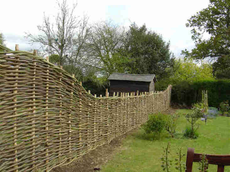 Continuous weave Hazel Wattle Woven Fencing made of whole rod or split rod hazel is £4.50 per square foot from Underwoodsman.