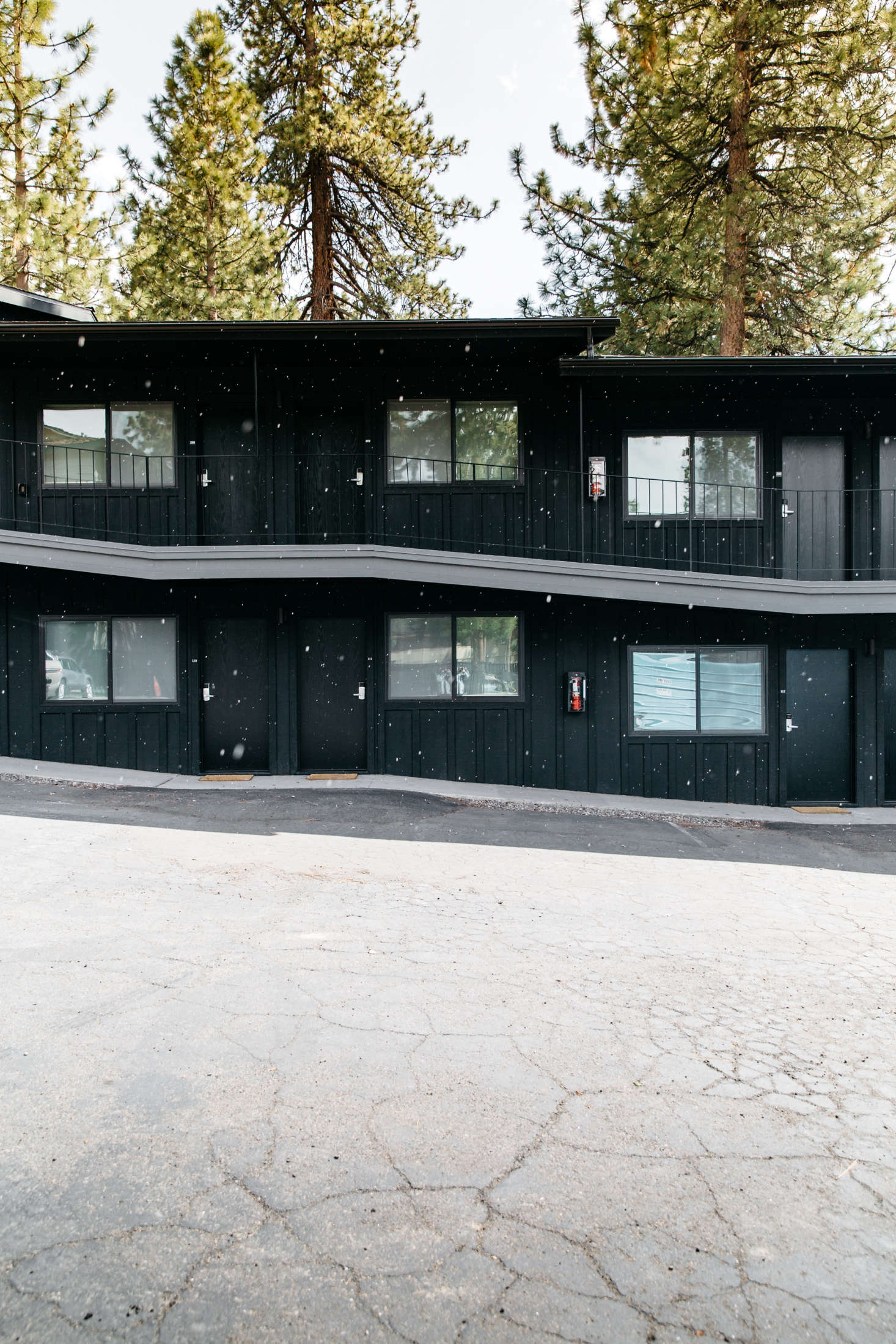At the Coachman Hotel in South Lake Tahoe, California, the exterior of the buildings were painted a unifying coat of Benjamin Moore Black Panther.Photograph by Luke Beard and Matthew Bolt, courtesy of the Coachman Hotel.