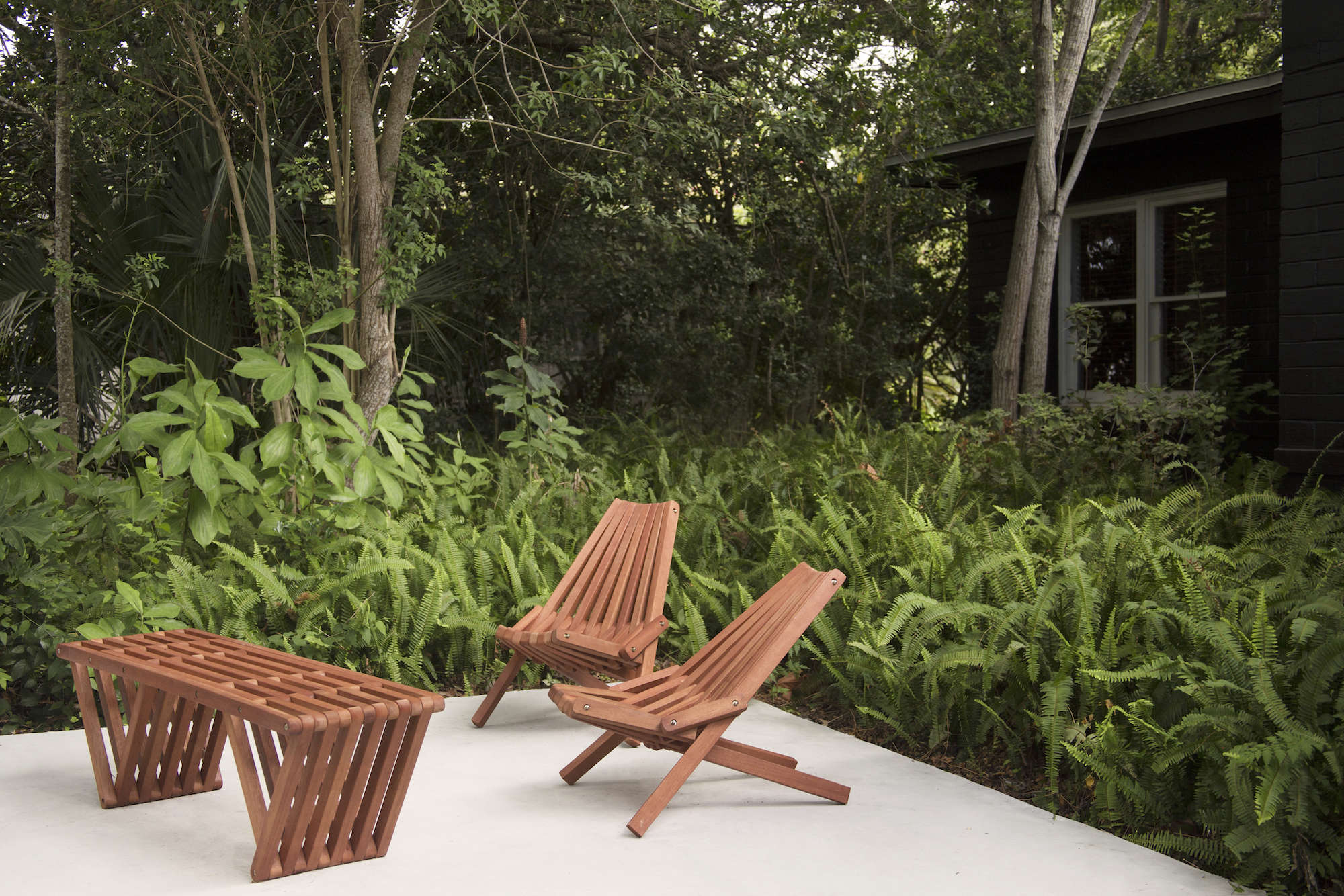 &#8\2\20;The natural setting of the house was one of the few things it had going for it when we bought it,&#8\2\2\1; said Deming. &#8\2\20;We aimed to leave the ferns and all of the growth as intact as possible.&#8\2\2\1; The patio furniture is from GloDea.