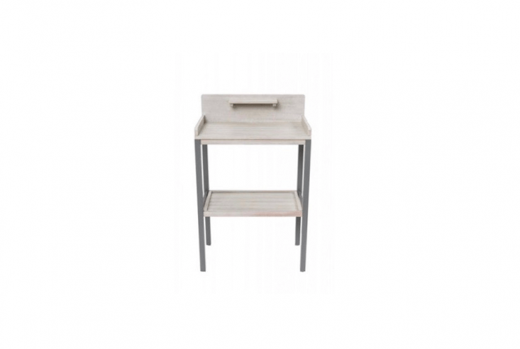 A gray-stained eucalyptusGrigio Potting Table is a diminutive .5 inches wide. For more information and pricing, see Florenity.
