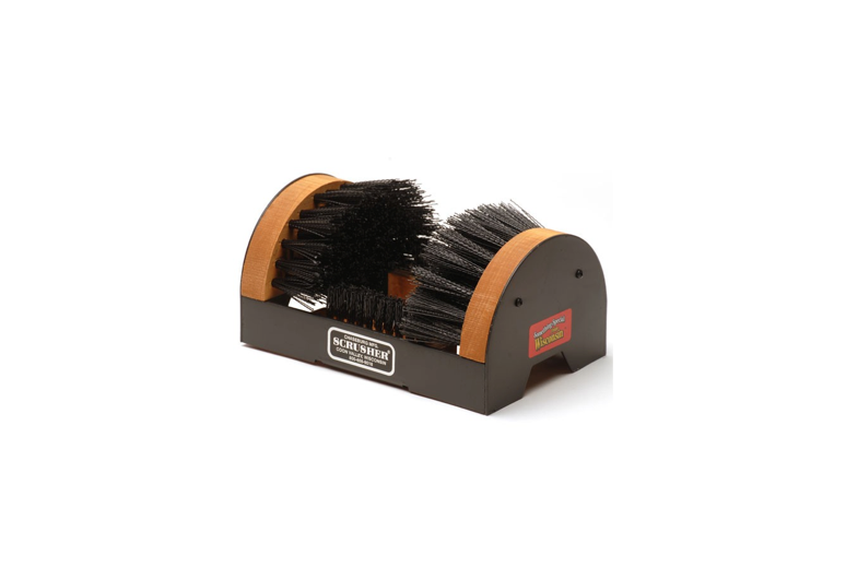 Wisconsin-based company Scrusher makes a variety of shoe-cleaning brushes for the front door. Their Original Scrusher (\$39.99) has evenly spaced bottom bristles to prevent a buildup of dirt and debris.