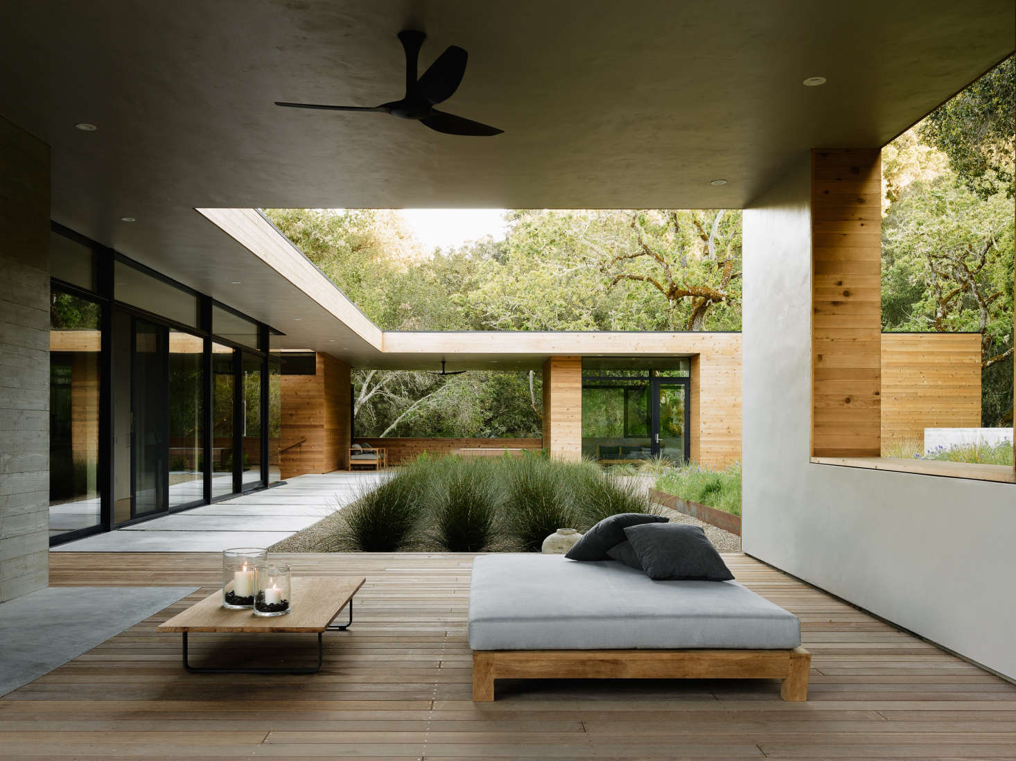 In Carmel Valley, California architects Sagan Piechota, and contractors Stocker Allaire designed an outdoor living room with plaster walls and a batu wood deck, jutting off the main, indoor living room. Photograph by Joe Fletcher courtesy of Sagan Piechota Architecture, from The California Life, Outdoor Living Room Included.
