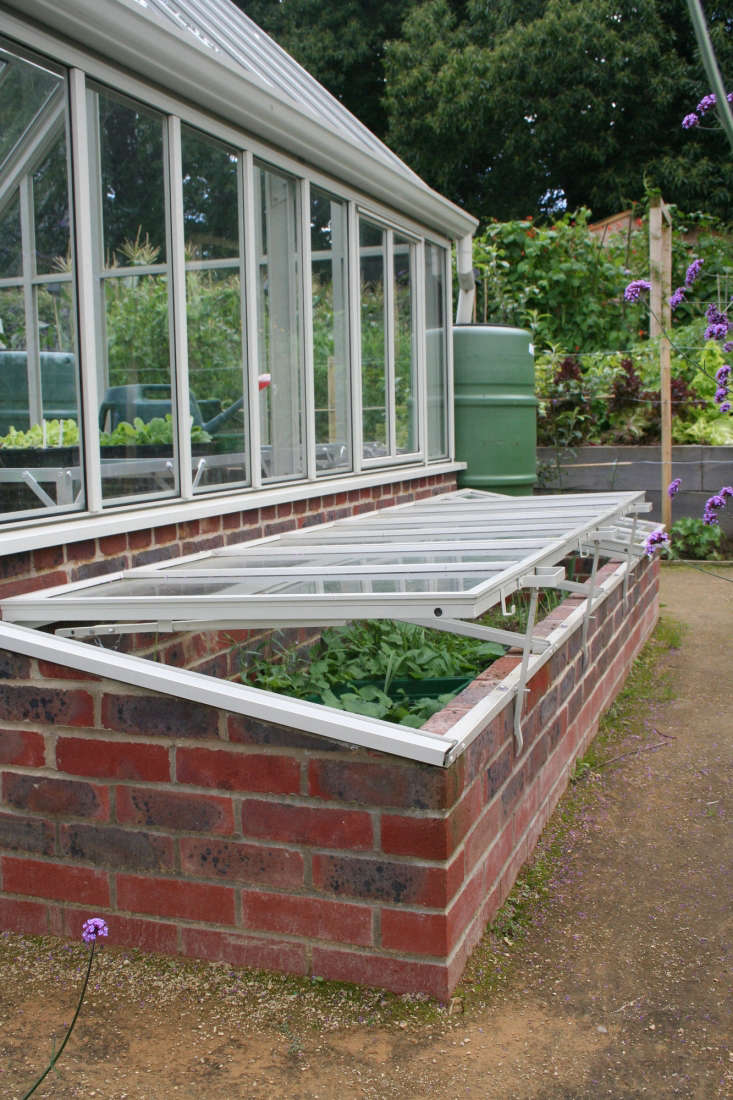 The greenhouse is flanked with cold frames, also from Hartley Botanic.