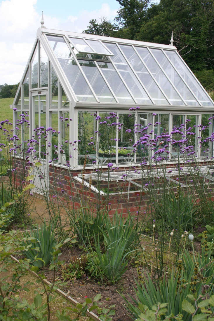 Historically, cold frames were built as greenhouse extensions tucked against the outer walls with southern exposure as seen (with their glass lids removed) outside Victorian glass houses. They offered a place to harden off seedlings on their journey from the cozy confines of the greenhouse to outdoor planting beds. Photograph courtesy of Annie Guilfoyle, from Before & After: A Kitchen Garden in Sussex, England.