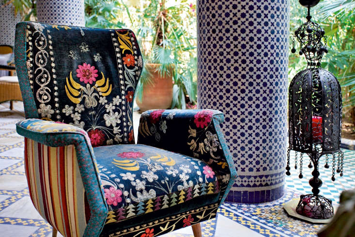 On the loggia at Riad Enija, a chair from the flea market has been reupholstered in vintage fabric.